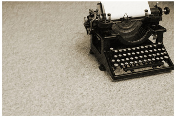 old typewriter with blank paper (2)