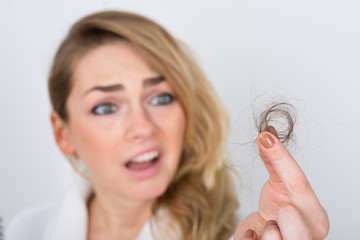 Woman Holding Loss Hair