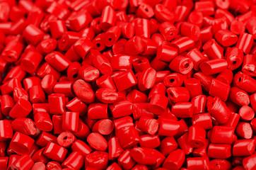 Red plastic grains