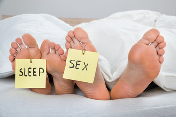 Four Feet With The Text Sleep And Sex On Label