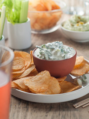 potato chips and fresh vegetables with dip