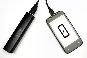 charging your cellphone with power bank, isolated