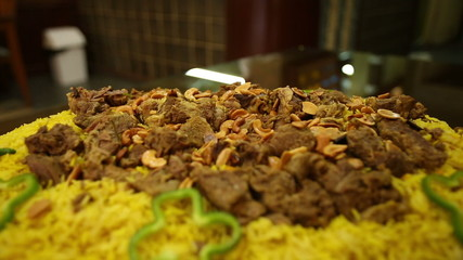 Serving rice and meat dish, kabsa