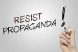 Hand writing resist propaganda poster