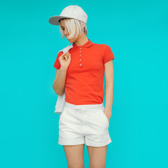 Sporty style. Girl in fashionable clothes and accessories