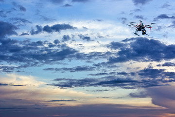 drone in the sky at sunset