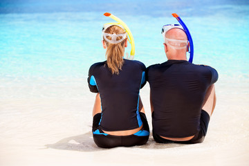 Couple of diver on the beach
