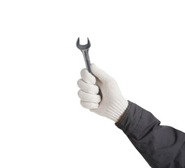 Working hand in glove holding wrench on a white background