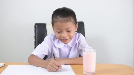 Asian kids - Thai girl doing homework with happiness