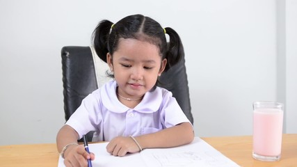 Asian girl - Thai kids drawing notebook