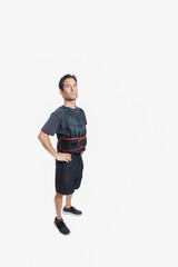 Confident man wearing weighted vest