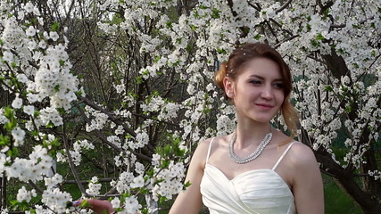 Bride standing in a beautiful spring garden