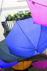 Decorative colorful umbrellas in a country fair. Color image