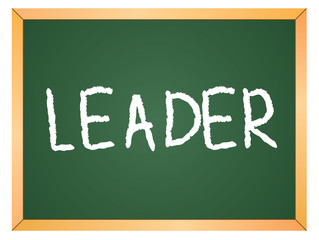 """leader"" word written on chalkboard"