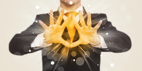 Hands creating a form with yellow shines