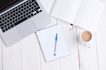 Workplace business. laptop, coffee, pen notebook