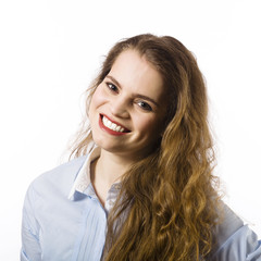 Portrait of a beautiful smiling young woman dressed in a blue sh
