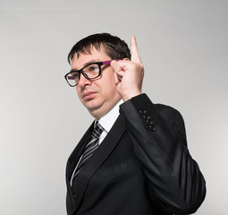businessman in a suit and glasses, the idea