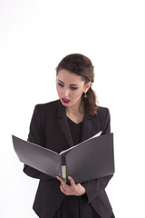 frightened business woman looking at documents in the folder
