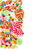 Fototapeta Colorful candies and lollipops isolated on a white background