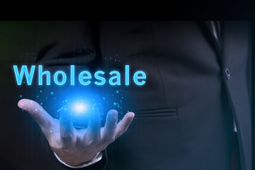 businessman showing wholesale word.marketing concept.