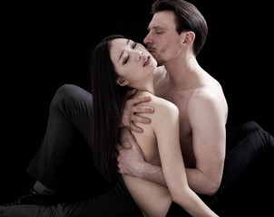 Beautiful bare-chested lovers intimate portrait