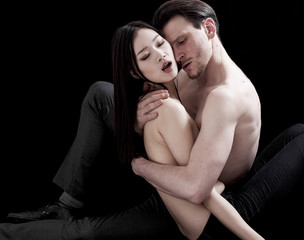 Beautiful and intimate bare-chested couple portrait hugging