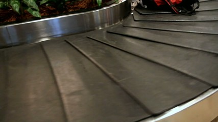 luggage on the conveyor in the airport