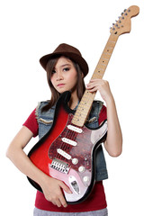 Pretty Asian girl holding her guitar, isolated on white