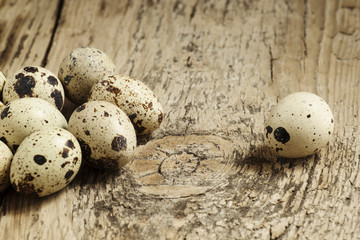 Quail eggs on a wooden table, selective focus