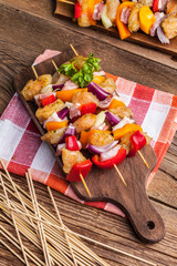 Raw skewers ready for grilling.