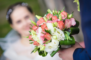 Wedding bouquet and happy couple