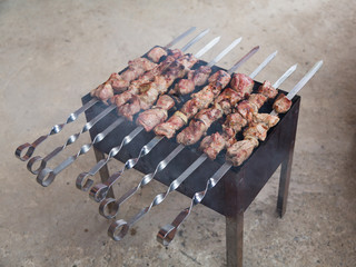 Appetizing shish kebab of lamb with fried onions on the grill