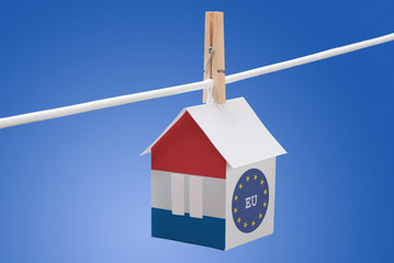 Netherlands, dutch and EU flag on paper house