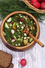 Okroshka with kvass in a wooden bowl