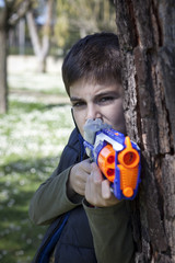 child plays with a gun