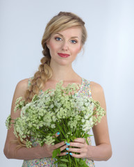 Young woman with beautiful hairstyle and flowers