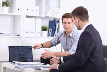 Business people talking on meeting at office, sitting