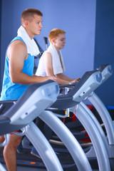 Man running on a treadmill in a fitness club