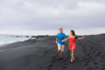 Couple walking travel holidays black sand beach