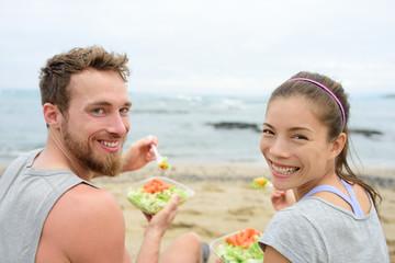 Vegan friends eating vegetarian salad lunch meal