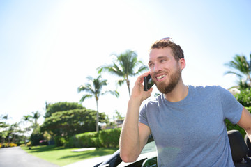 Urban smart casual young man talking on smartphone