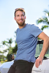 New car owner - happy young man portrait
