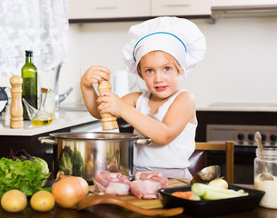 girl cooking soup in pan