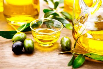 Olives and bottles of virgin olive oil