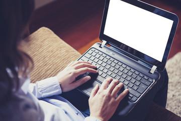 Laptop on the knees. White screen.