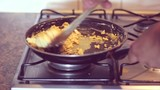 Man making scrambled eggs