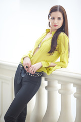 emotional beautiful brunette in yellow blouse