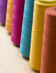 several of multi-colored spool of threads