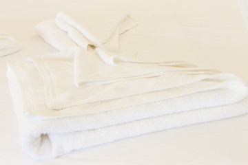 Clean white towel on white background